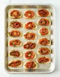 Crunchy crostinis with basil pesto and oven roasted tomatoes
