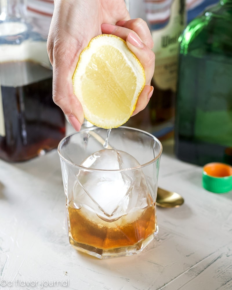 Squeezing lemon into a Man o War Cocktail