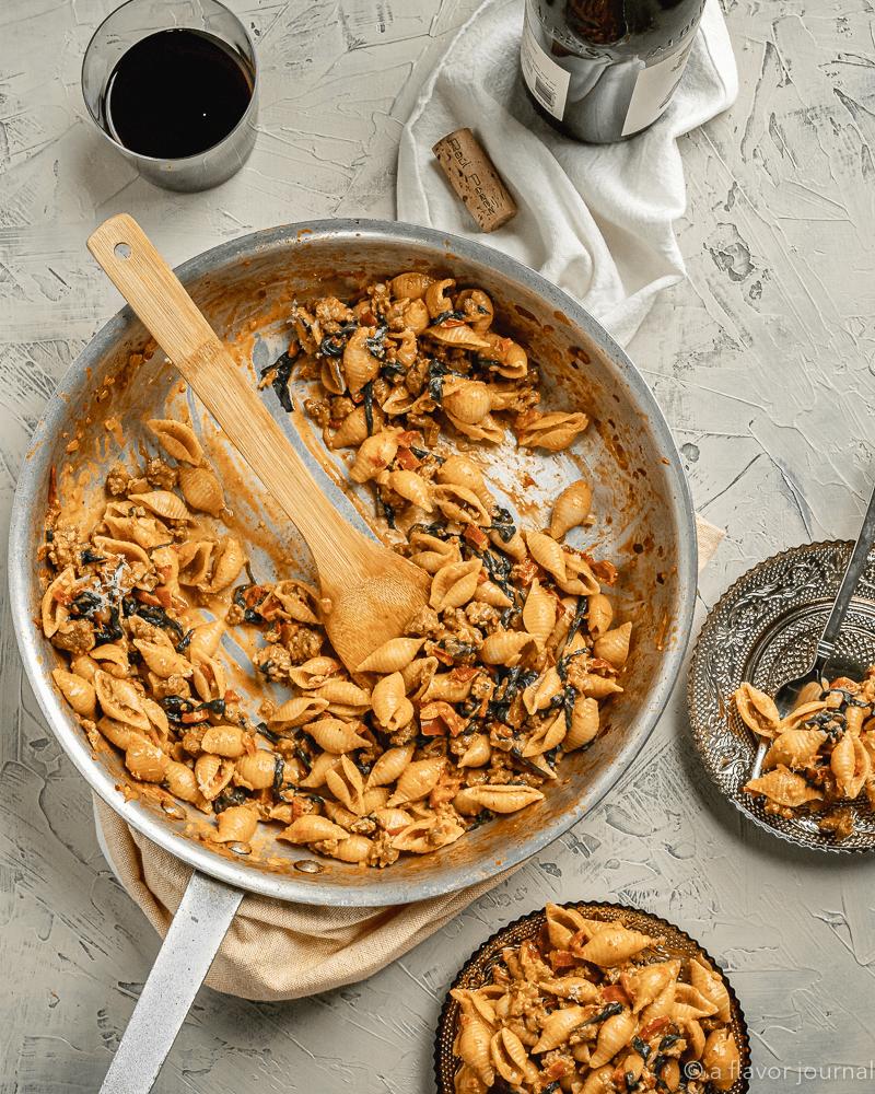 A skillet full of Creamy Chorizo Spinach Pasta