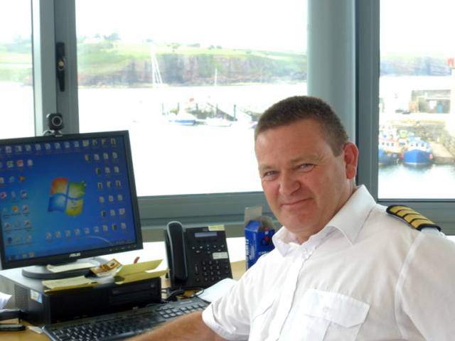 Dunmore East Harbour Master Harry McLoughlin in his control centre atop the new Harbour Services Building, with the busy new Visitors Pontoon beyond