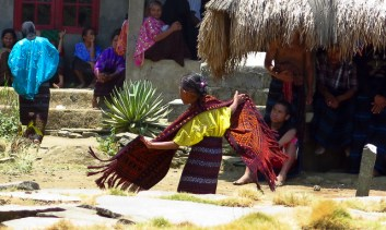 A young girl dancing. Pemo village, Flores.