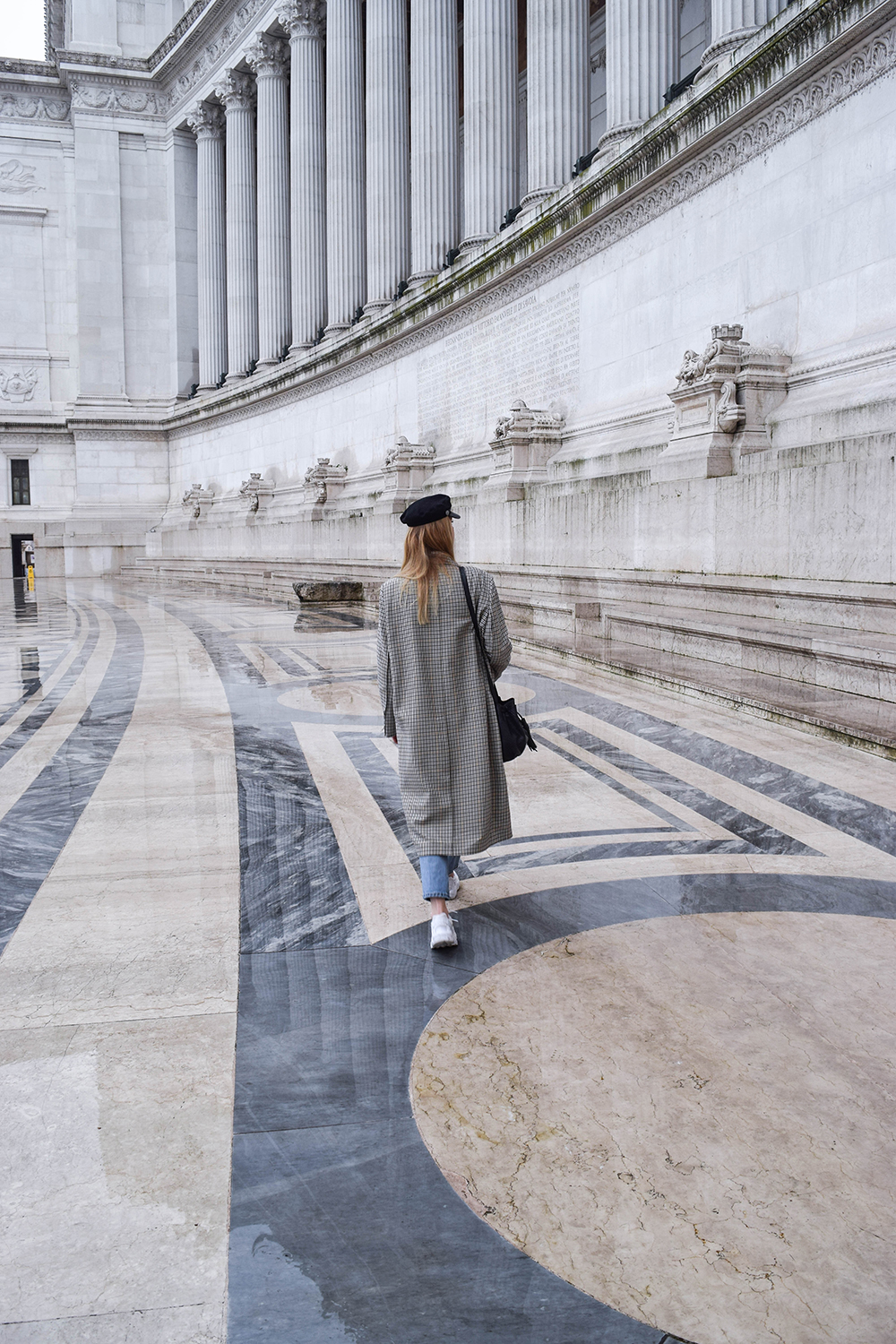 Girl with H&M checked coat in Vittorio Emanuele monument in Rome