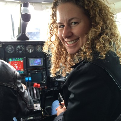 Robin Sofer in the cockpit of an aircraft.