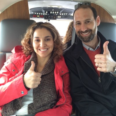 Dr Ian Shulman and a woman giving a thumbs up, on her first flight in 7 years