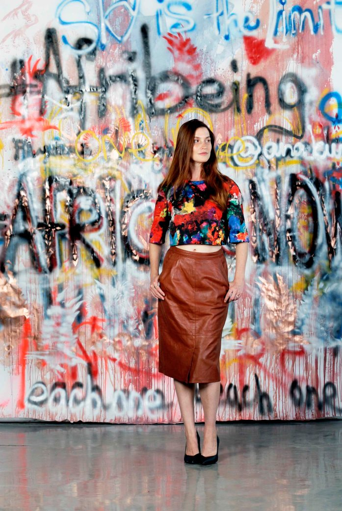 Co-Founder of Afribeing, Lindi Hingston standing in front of Ana Kuni curated graffiti wall Africa is Now