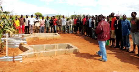Farmers listening to researchers explainon-ging trials to estimate run-offwater from farmers fields in the region