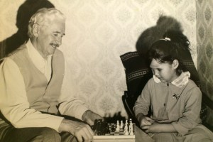 January 1992: Alexandra (right) playing with her grandfather Alexandr Ostry in Kiev, Ukraine