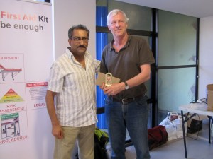 Nairobi Chess Club's Peter Gilruth (right) receiving his prize for first place (overall) from KAM Pharmacy Director Karim Rahemtulla / Photo by Kim Bhari