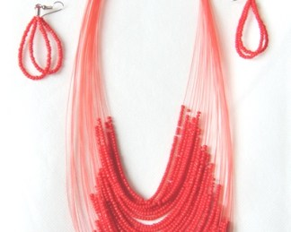 Set necklace and pair of aerrings red color