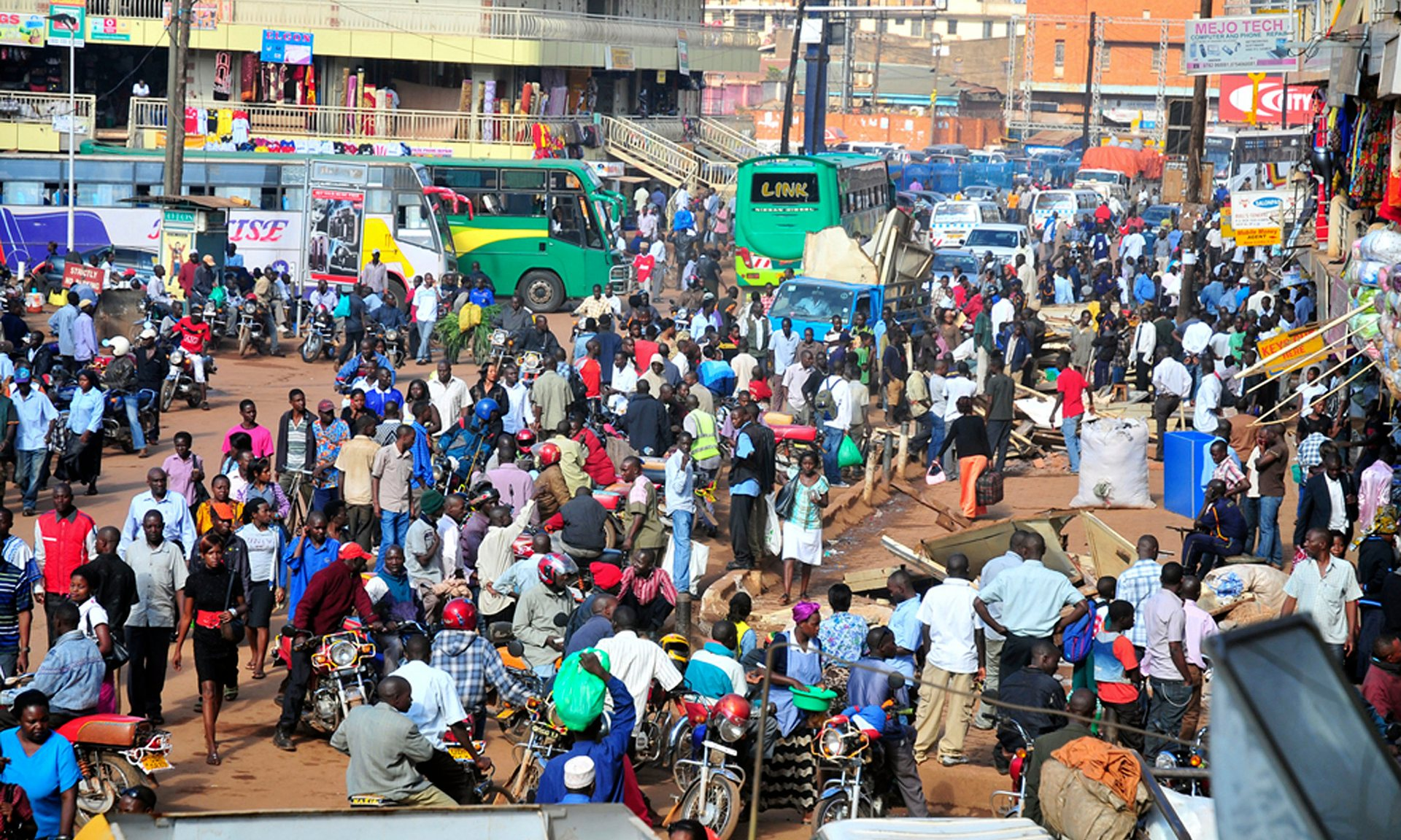 A bus terminal in Kampala. Poor infrastructure hinders growth, but Uganda risks not being able to service its debts. Photograph: Ronald Kabuubi/AP