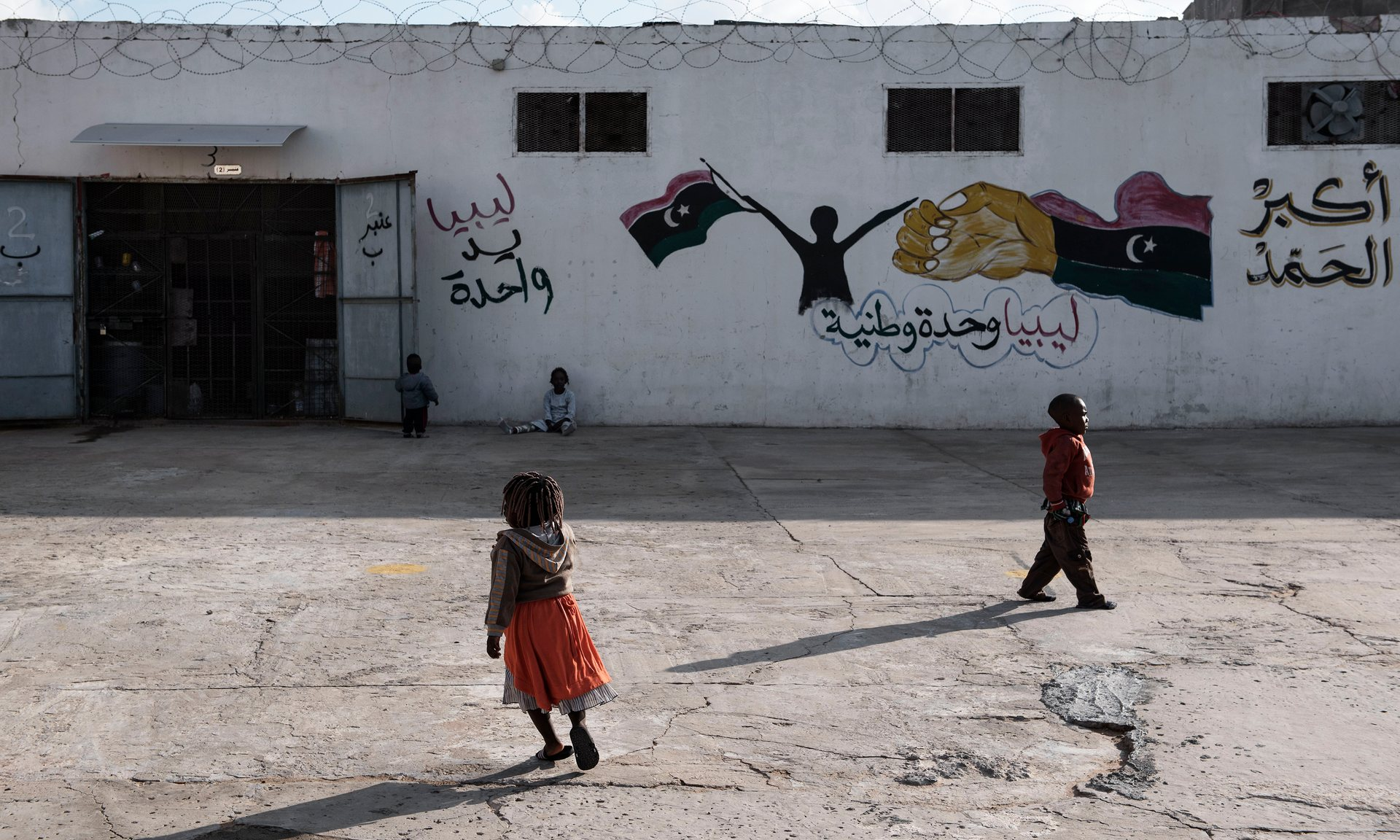 Children outside a government-run detention centre in Libya. Photograph: Romenzi/Unicef