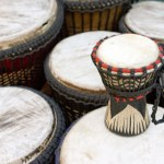 Music African drums at market stall - landscape exterior