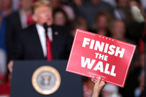 """Photo of sign saying """"Finish the Wall"""" at a Trump rally in this article on border security by African American Conservatives. Photo credit: Gage Skidmore"""
