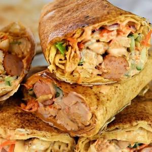 Nigerian Chicken & beef Special Shawarma with 2 large hot dogs.