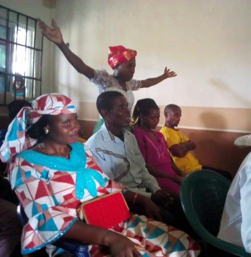 A Denominational women leader accepting Christ at Ikot Osute