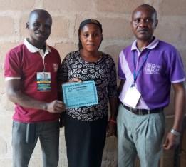 A new convert Peace Morris received Baptismal Certificate