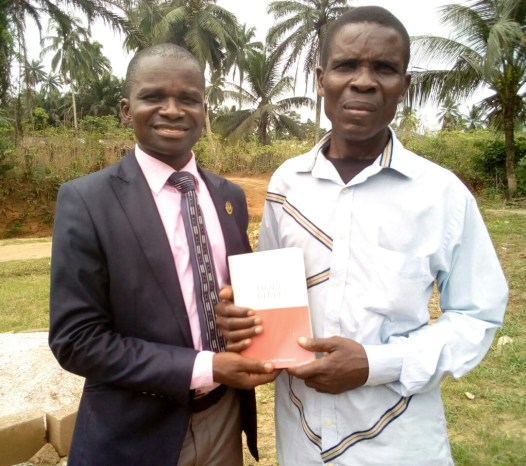 A newly baptized at Ikot Osute received Bible on Feb 18,2018