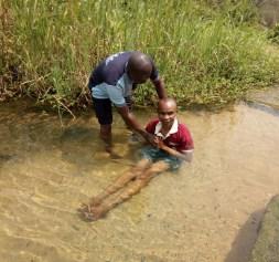 Ime Inuaeyen being baptized by Mojima Etokudo
