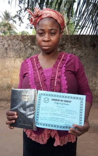 Sister Idongesit received Bible & Baptismal Certificate