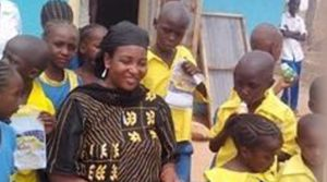Khuraira Musa in the midst of pupils of Zainab Memorial School, the school she founded