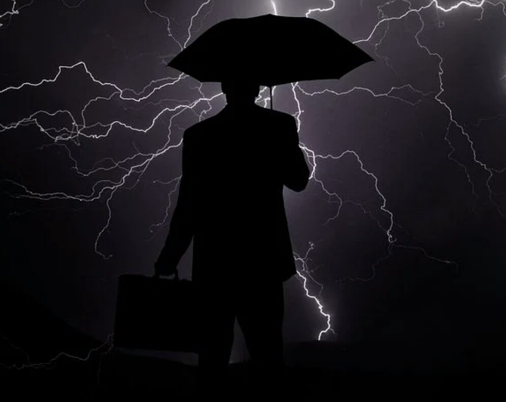 A brave man with an umbrella