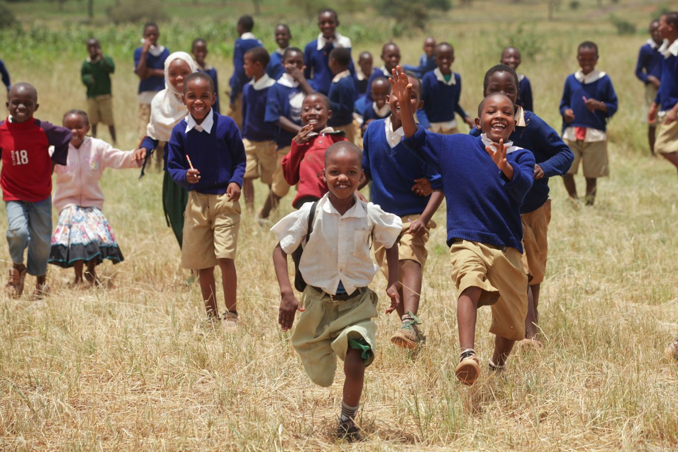 Rural children run outside while attending a Wildlife Club, one of APW's environmental education programs.