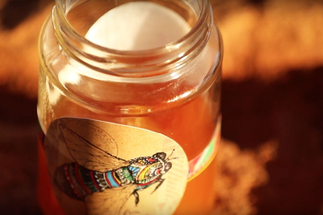 Honey produced by APW's Women's Beekeeping Initiative is sold under the Mama Asali brand