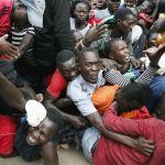 Hundreds injured in a stampede over food aid in Kenyan slum