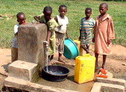 Uganda children at water tap