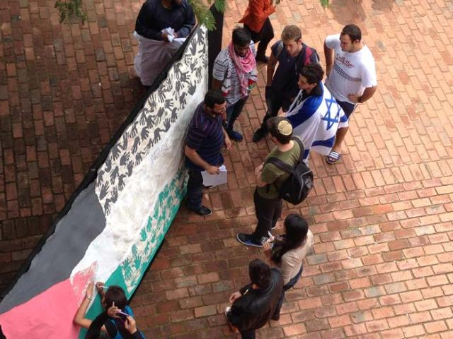 Israeli and Palestinian flags at a campus demonstration: