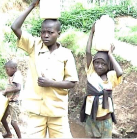 Rwandan boys carry water from well