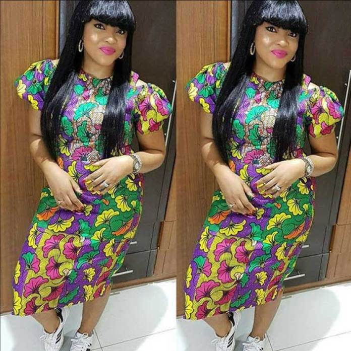 Short ankara gown with sneakers