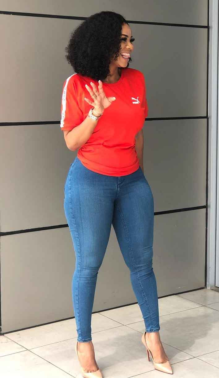 Serwaa Amihere in red top and jeans