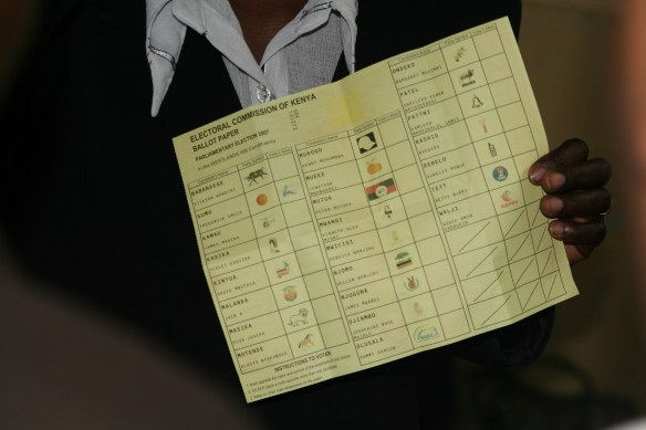 Kenya election 2007 ECK Presiding Officer holding ballot with disputed marking