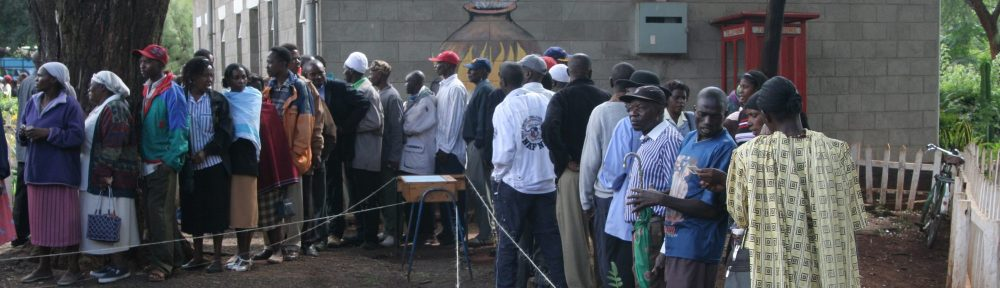 "Kenya election 2007 votes in line at Lavington Primary School polling place with mural ""Curriculum Cooking"""