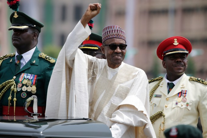 New Nigerian President, Muhammadu Buhari, salutes his supporters during his Inauguration in Abuja, Nigeria, Friday, May 29, 2015. Nigerians celebrated their newly reinforced democracy Friday, dancing and singing songs and praises at the inauguration of Muhammadu Buhari, the first candidate to beat a sitting president at the polls. (AP Photo/Sunday Alamba)