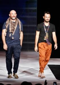 NEW YORK, NY - SEPTEMBER 15: Designers Christiaan Gabriel du Toit and Malcolm Kluk of KluK CGDT walk the runway at Arise Made In Africa Spring 2012 Designer Collective at Mercedes Benz NY Fashion Week at Avery Fisher Hall at Lincoln Center for the Performing Arts on September 15, 2011 in New York City. Mark Von Holden/Getty Images for Arise Made in Africa/AFP