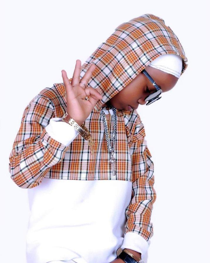"""""""Stay in school"""" - Minister tells youngest rapper, Fresh Kid"""