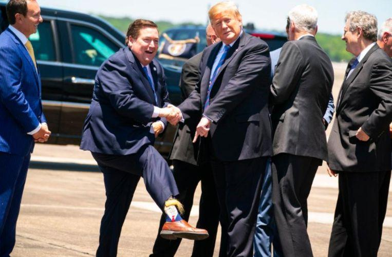 Billy Nungesser greets US President with bizarre (hairy) Trump socks