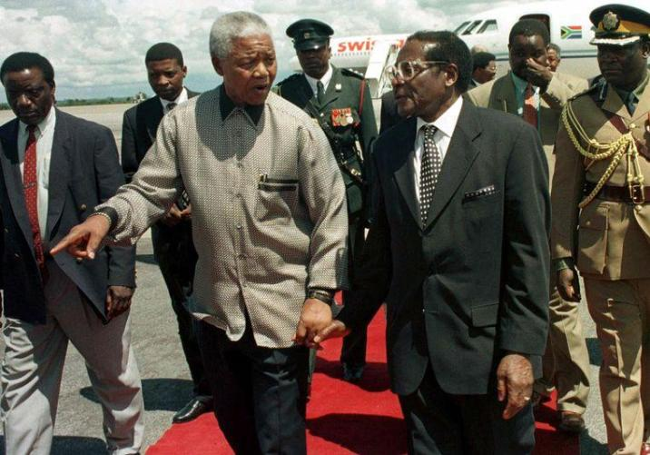 With former South African president Nelson Mandela in 1998.