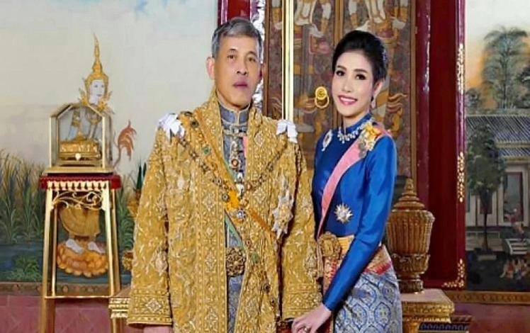 Thai king fires 'royal bedrooms guards' for adultery and 'inappropriate acts'