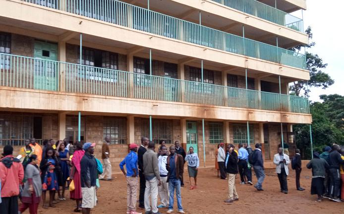 Parents and teachers gather at the school in Kakamega, Kenya, where tumult at least thirteen children became fatal