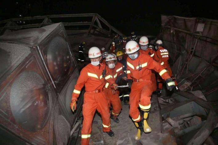 Rescuers evacuate an injured person from a collapsed hotel building in Quanzhou city in southeast China's Fujian province Saturday, March 07, 2020. The hotel used for medical observation of people who had contact with coronavirus patients collapsed in southeastern China on Saturday, trapping dozens, state media reported. (Chinatopix Via AP)