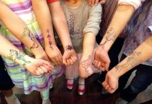Tired of bad summer weather? Entertain your kids with a fake tattoo