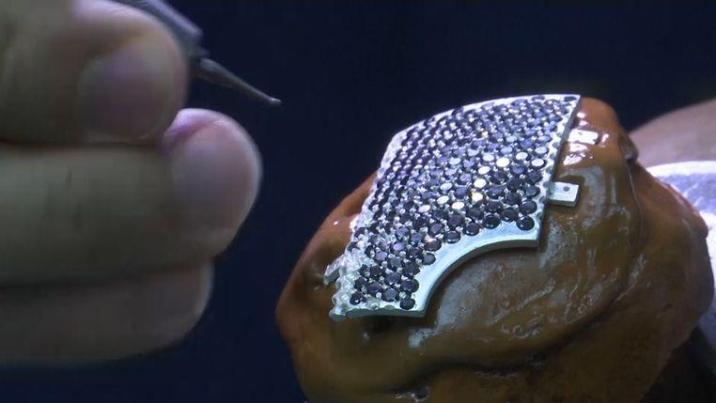 Jeweler working on the Gold mouth mask