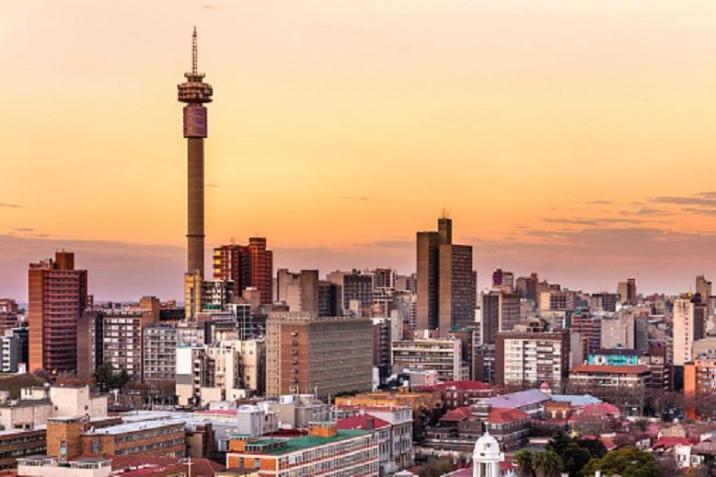Johannesburg sunrise with Telkom communications tower cityscape.