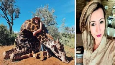 Hunter poses with a shot giraffe as a Valentine's gift
