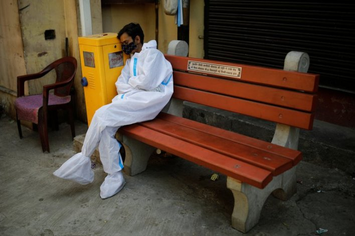 An exhausted worker, due to the days of care for patients with COVID-19 in New Delhi, India