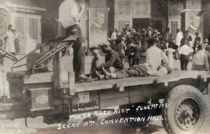 June 1, 1921: A white man guards imprisoned black residents of Tulsa