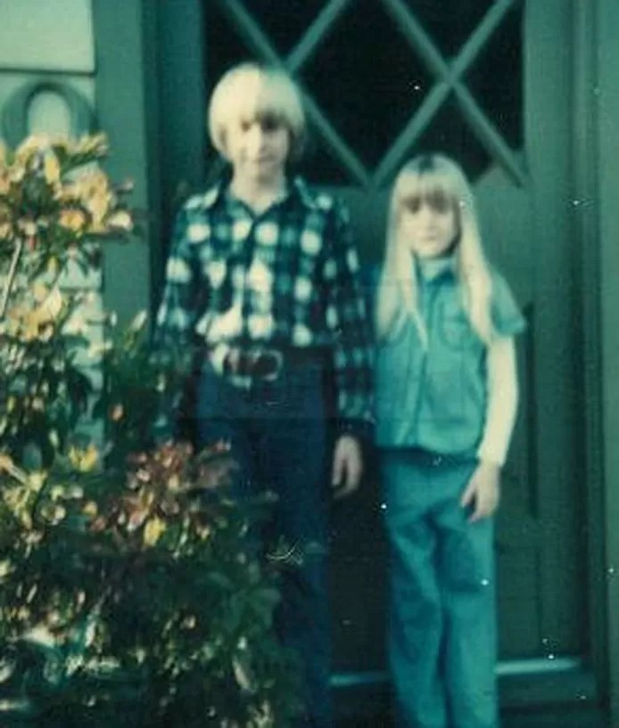 Kurt Cobain and his sister Kim at the front door of the family home.